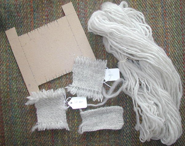 Sample 'loom', woven and knit samples, and unsized skein