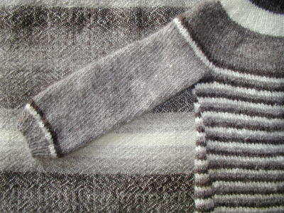 examples of tracking and slanted stitches due to unbalanced yarns