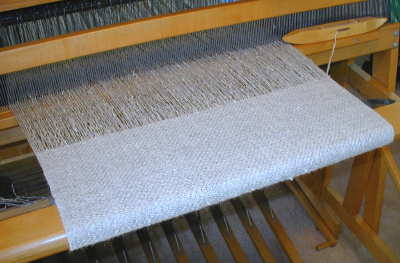 Cloth being woven